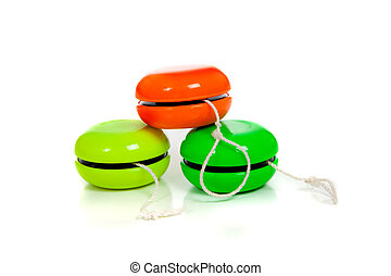 Green and red yoyos on a white background with copy space