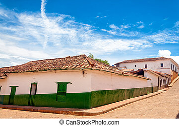 Green and White Colonial Buildings