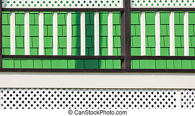 Green and white wooden house detail