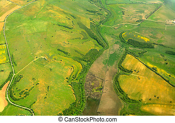 green and yellow field seen from above