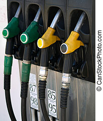 Green and yellow gas  pump rack