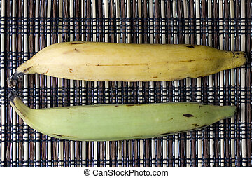 Plantains - Green and yellow Plantains on placemet