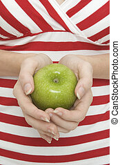Green Apple 2 - A girl holds a green apple