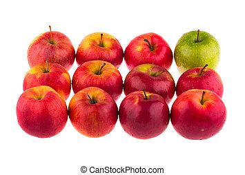 Green apple among red apples on white background.