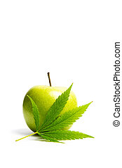 Green apple and marijuana leaf isolated