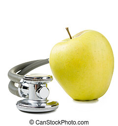 green apple and medical stethoscope. Medical costs,...
