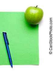 Green apple and pen isolated on white