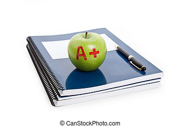 Green apple and Textbook close up
