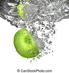 green apple dropped into water isolated on white