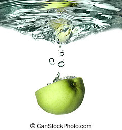 green apple dropped into water with splash isolated on white