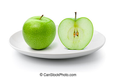 green apple in a plate isolated on a white background