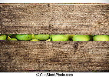 Green apple in a wooden box