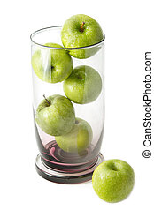 Green apple in glass bowl