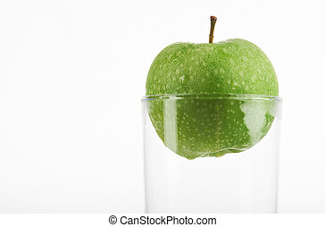 Green apple in glass