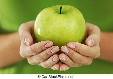 apple in woman hands - green apple in woman hands