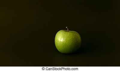 green apple on black background