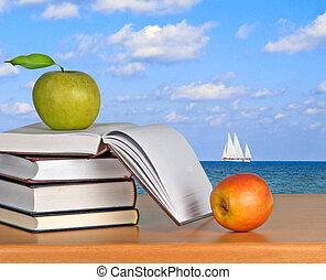 Green apple on book