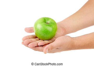 Green apple on hands.