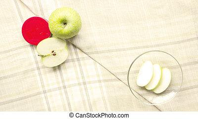 Green Apple sliced on glass plate