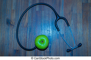 Green apple, stethoscope