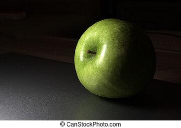 Green apple under the light