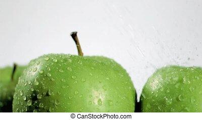 Green apple watering in super slow