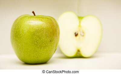 Green Apple with Half in Background