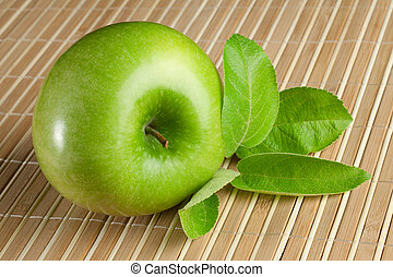 Green apple with leaves