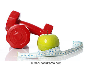 Green apple with measuring tape on the background of...