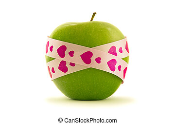 Green apple with pink gift ribbon