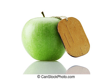 green apple with tag isolated on white background
