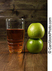 Green apples and a glass of juice
