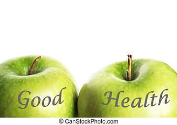 Photo detail of two green apples with the word: good health on them, on the white background