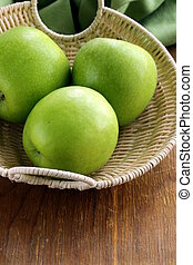 """green apples """"Granny Smith"""" in a basket on the table"""