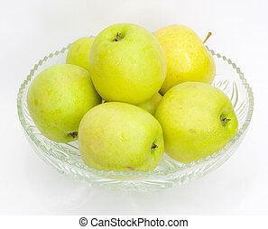 green apples in a glass jar
