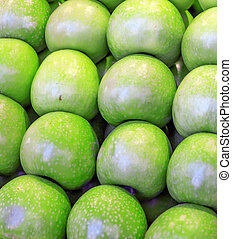 green apples in a market stand
