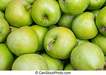 green apples in a wooden box