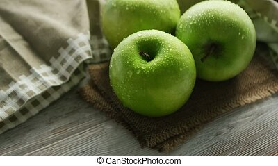 Green apples in water drops - From above closeup shot of...