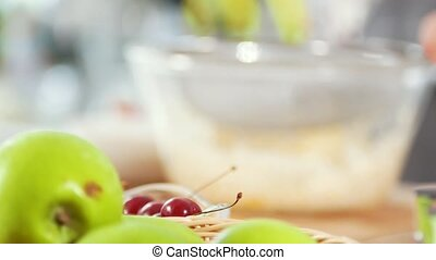 Green apples on the table in front of child hands...