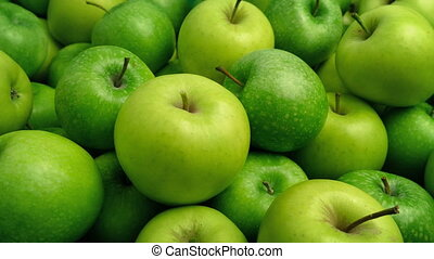 Green Apples Pile Closeup - Tracking shot moving slowly past...