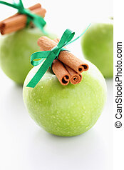 Green apples with cinnamon sticks