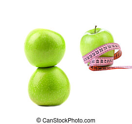 Green apples with tape measure.