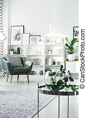 Green armchair with pillow