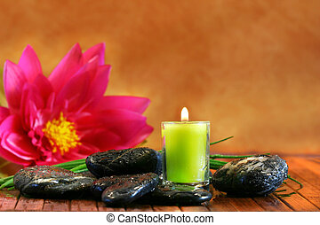 Green aromatherpy candle with tropical flower