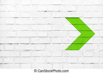 Green arrow on white wall