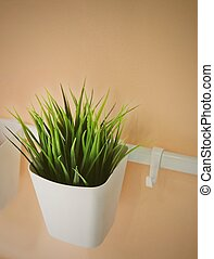 Green Artificial Plant in A White Pot