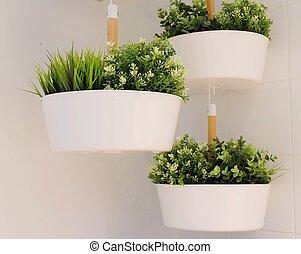 Green Artificial Plants in A Metal Pot