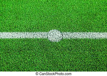green artificial turf - An football field with green...