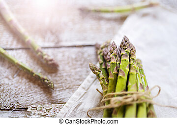 Green asparagus - Bunch of fresh green asparagus spears tied...