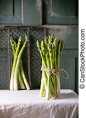 Green asparagus - Bundle of green asparagus over white...